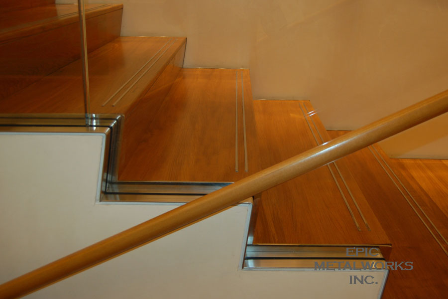 Stainless Steel Stair Nosing And Stainless Steel Base Cap.